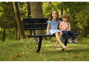 Children resting and relaxing on a park bench
