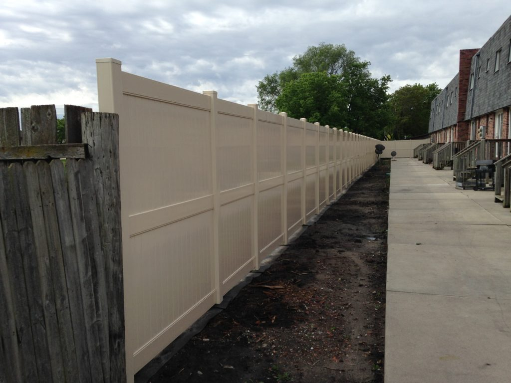 Vinyl privacy fence with middle rail in the color khaki